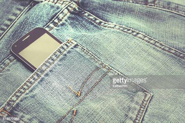 mobile phone kept in a jeans pocket