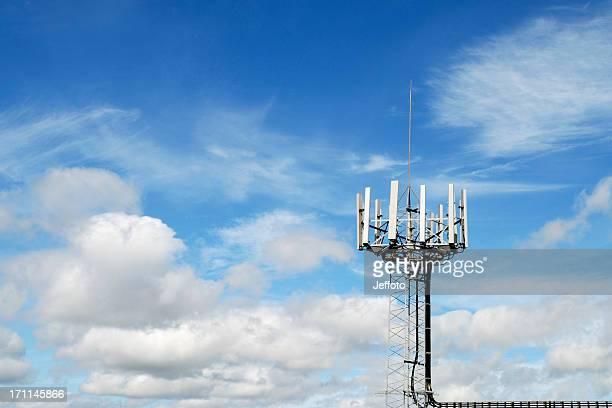 Mobile phone mast against blue sky