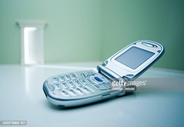 Mobile phone on floor (focus on phone)