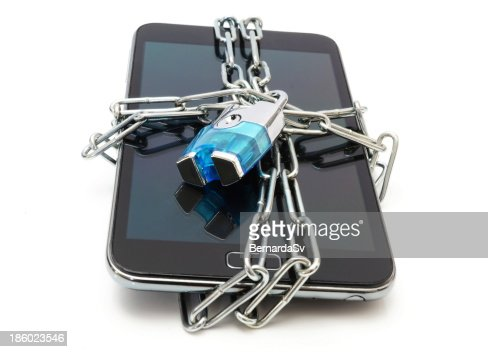 Mobile phone secured with chain and lock on white background : Stock Photo