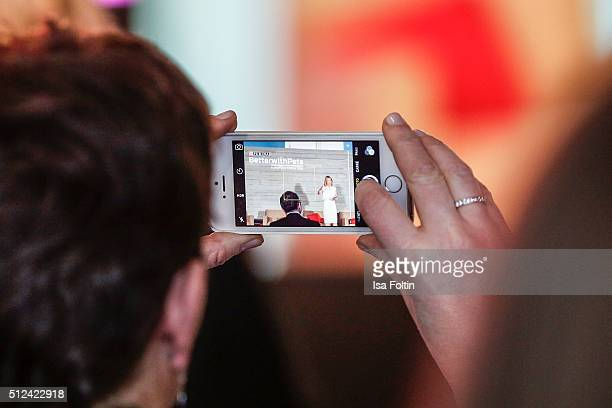Mobile phone shoot of Lucy Alexander during the Better With Pets Forum 2016 with following themes Understanding the macro trends affecting future pet...
