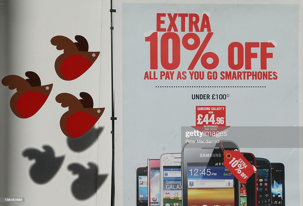 A mobile phone shop advertises an extra discount in Oxford Street on December 17, 2012 in London, England. Thousands of shoppers are expected in London's west end in the hunt for Christmas bargains in the next week.