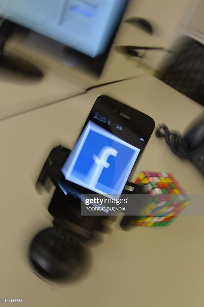 A mobile phone showing a Facebook page, in Quito, on May 10, 2012. AFP PHOTO/RODRIGO BUENDIA
