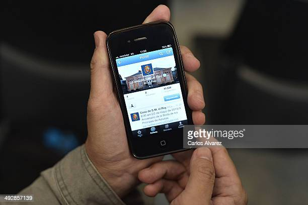A mobile phone shows the new Twitter account by Spanish Royalty on May 22 2014 in Madrid Spain The account was unveiled on May 21 2014