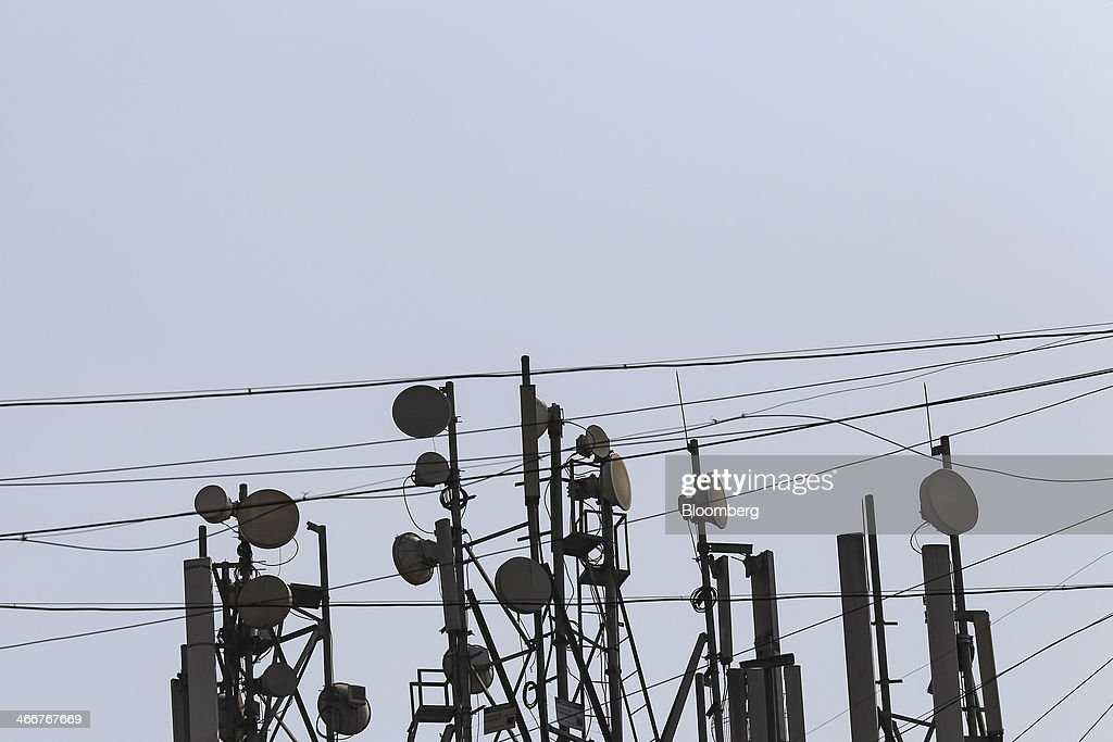 Mobile phone telecommunications towers stand in Mumbai, India, on Wednesday, Jan. 29, 2014. India got bids totaling 446.1 billion rupees ($7.12 billion) on the first day of a wireless spectrum auction on Feb. 3, the third effort by the government to raise revenue from the sale of airwaves in the last 15 months. Photographer: Dhiraj Singh/Bloomberg via Getty Images