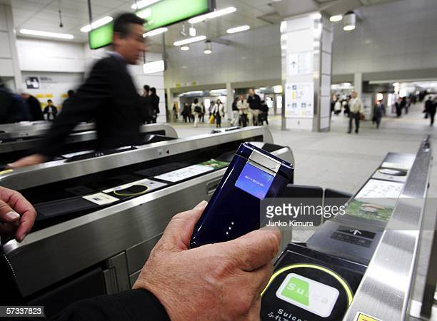 Mobile Phone with prepaid function is seen at a station where users can go through ticket gates with mobile phones without a paper ticket on April 14...