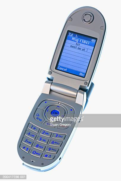 Mobile phone with text message, close-up