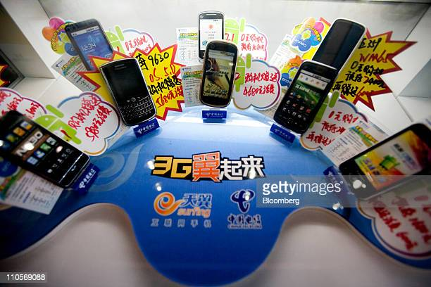 Mobile phones are sold at a China Telecom Corp store in Beijing China on Tuesday March 22 2011 China Telecom the country's biggest fixedline carrier...