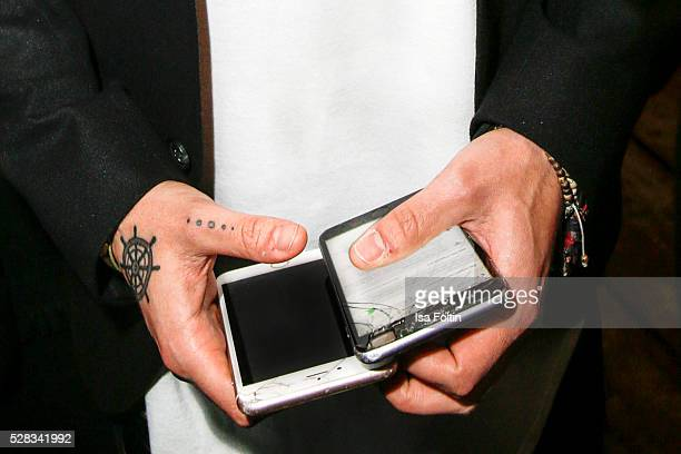 Mobile phones in the hands of Tom Kaulitz as a detail at the photo art exhibition and book launch of BILLY at Seven Star Gallery on May 4 2016 in...