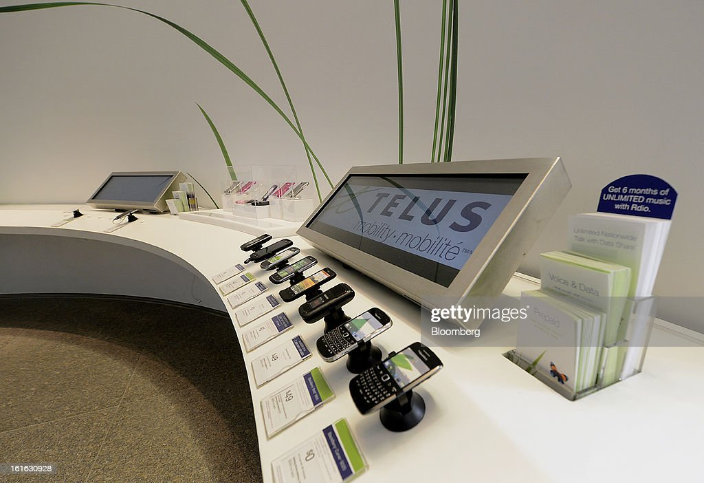 Mobile phones sit on display at a Telus Corp. learning center and store in Toronto, Ontario, Canada, on Wednesday, Feb. 13, 2013. Telus Corp. is scheduled to release earnings data on Feb. 15. Photographer: Aaron Harris/Bloomberg via Getty Images