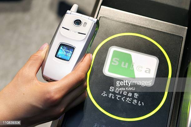 Mobile Phones To Be Used As Train Tickets Commuter Passes Prepaid Cards In Tokyo Japan On February 22 2005 A model scans NTT DoCoMo's handset over a...