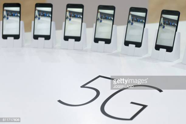 Mobile phones with 5G are displayed at the Mobile World Congress in Barcelona on February 22 2016 The world's biggest mobile fair is held from...