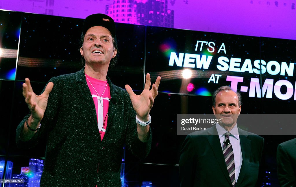 T Mobile President and CEO John Legere (L) and Major League Baseball's Executive Vice President of Baseball Operations Joe Torre appear at a news conference at the 2013 International CES at The Venetian on January 8, 2013 in Las Vegas, Nevada. CES, the world's largest annual consumer technology trade show, runs through January 11 and is expected to feature 3,100 exhibitors showing off their latest products and services to about 150,000 attendees.