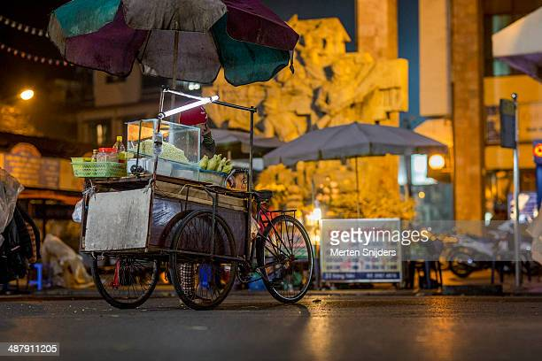 Mobile restaurant bicycle cart at night