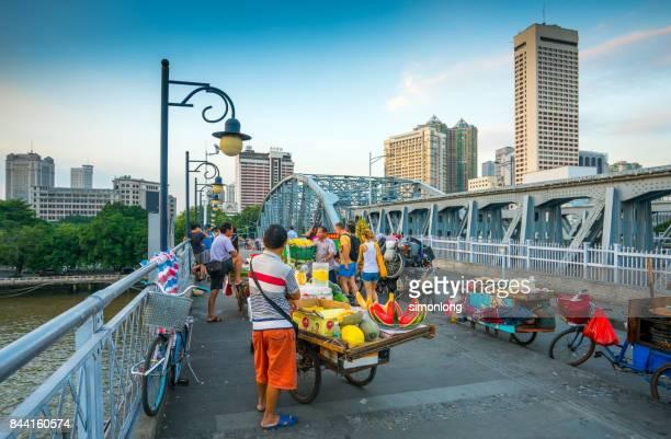Mobile stalls on a bridge