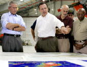 US President George W Bush and Homeland Security Secretary Michael Chertoff get a briefing from Federal Emergency Management Agency chief Michael...