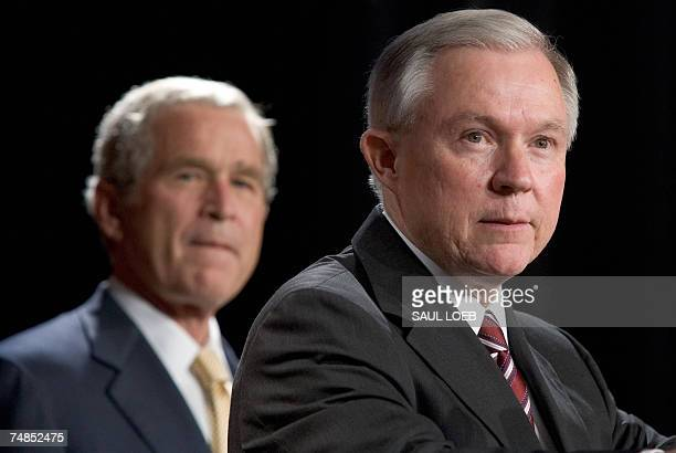 US President George W Bush listens as Alabama Senator Jeff Sessions speaks during a Republican fundraiser for Sessions at the Arthur R Outlaw Mobile...