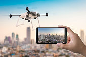 3d rendering mobile phone with flying drone