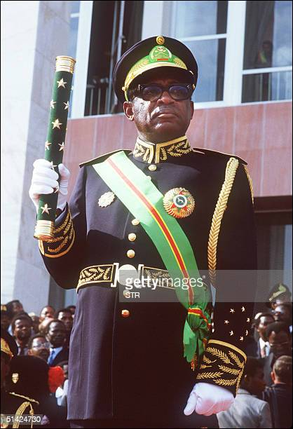 Mobutu Sese Seko president of Zaire holding a stick stands 05 December 1984 during the swearingin ceremony for his third seven year term as president...