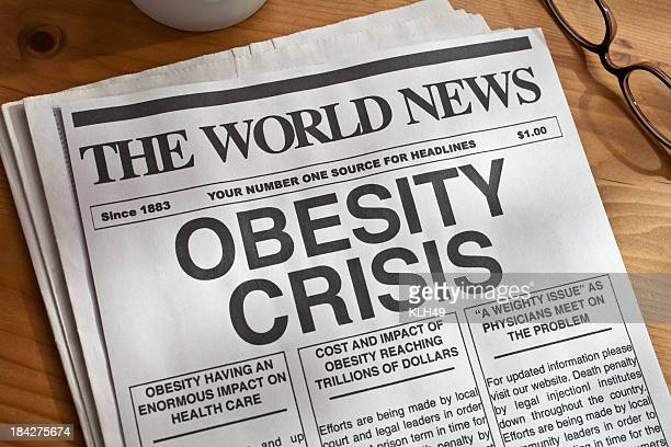Mock newspaper with big headline on obesity crisis