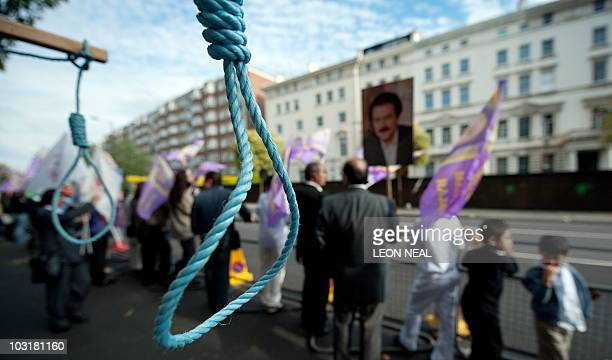 Mock nooses are displayed as supporters of the People's Mojahedin Organisation of Iran take part in a demonstration outside the Iranian embassy in...