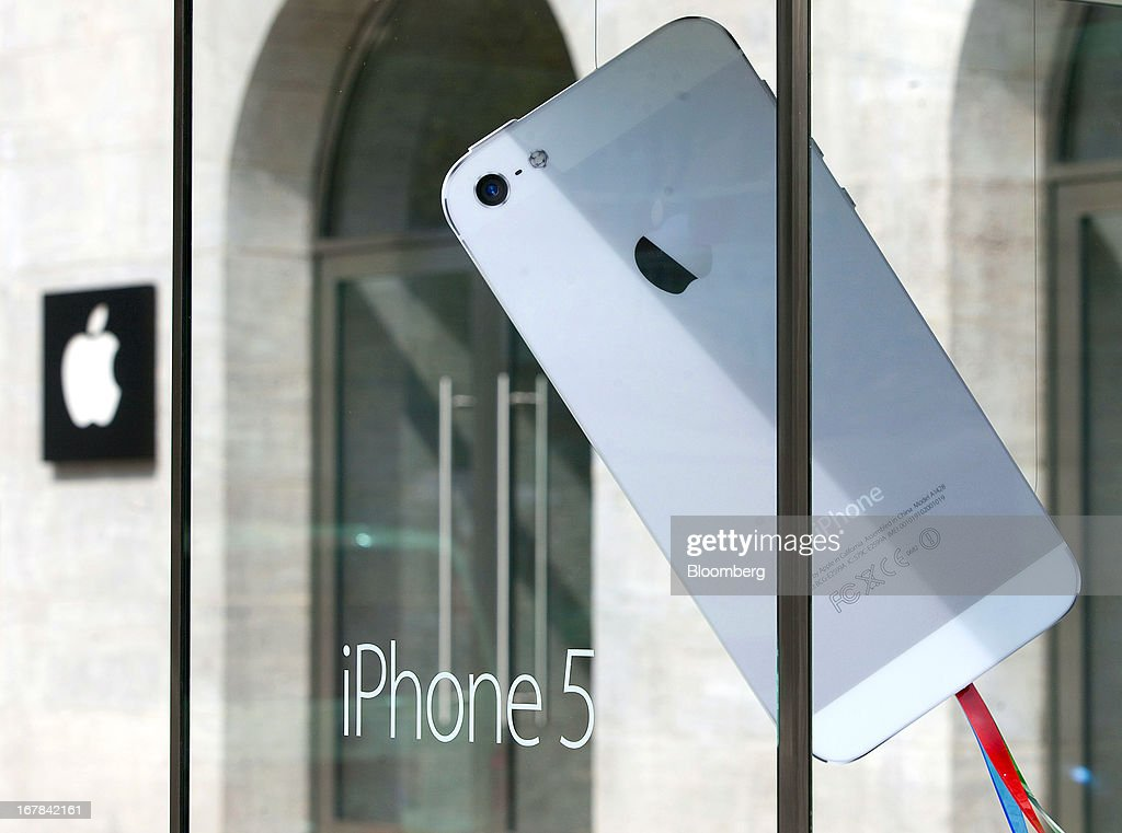 A mock oversized Apple Inc. iPhone 5 is seen in a display case outside the new Apple Inc. store ahead of the opening on Kurfurstendamm Street in Berlin, Germany, on Wednesday, May 1, 2013. The Berlin Apple Inc. store is the company's 11th in the country, but the first in Germany's capital city. Photographer: Krisztian Bocsi/Bloomberg via Getty Images