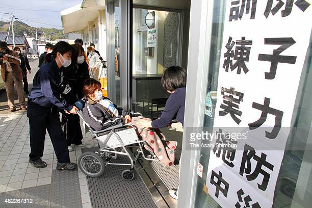 Mock patients are taken to an evacuation center during the threeprefecture joint emergency evacuation exercise on January 24 2015 in Matsuura...