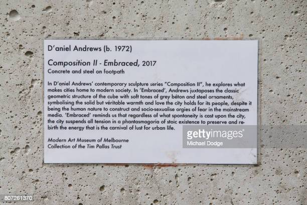 A mock plaque dedicated to Premier of Victoria Daniel Andrews is seen on a concrete block acting as bollards on July 4 2017 in Melbourne Australia...