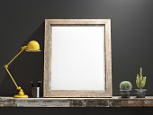 Mock up Frame on Wooden table, grey wall