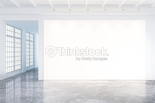 Mock up of blank poster in modern loft interior stock photo thinkstock