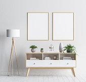 Mock up poster frame in living room background, Scandinavian style interior, 3D render