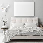 Mock up poster in hipster bad room , deer horns decoration on the wall, 3d render, 3d illustration