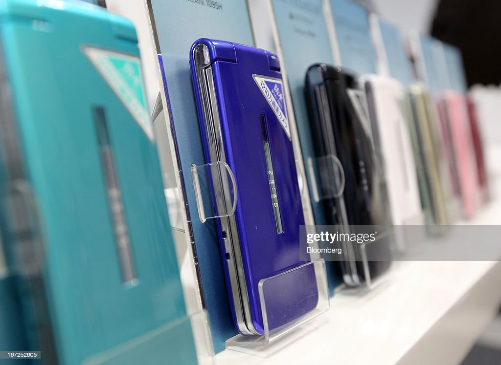Mock-up mobile phones are displayed at a Softbank Corp. store in Tokyo, Japan, on Sunday, April 21, 2013. The number of smartphone subscribers in Japan surged to 37 percent of all contracts as of March 31 from 3 percent three years earlier, according to Tokyo-based MM Research Institute Ltd. Photographer: Yuriko Nakao/Bloomberg via Getty Images