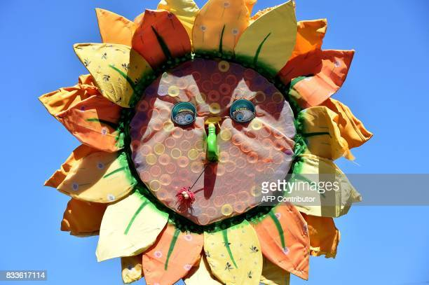 A mockup of a sunflower is pictured during a demonstration as reapers from the French Ariege department arrive for their trial at the Correctional...