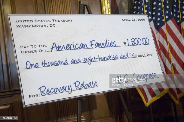 A mockup of a tax rebate check waits for House Speaker Nancy Pelosi DCalif House Majority Leader Steny Hoyer DMd and House Minority Leader John A...