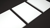 Mockup of three White A4 paper sheets on black background. Soft shadow. High resolution 3d render.