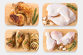 Mockup raw chicken and grilled chicken on cutting board set isolated on white background. Clipping Path included isolated on white background.