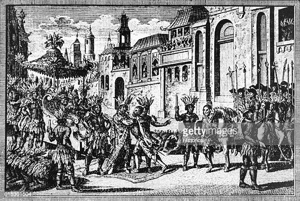 Moctezuma II the Aztec ruler of Mexico meets Hernan Cortes and his men at the edge of Mexico City Moctezuma tried to keep Cortes from entering and...
