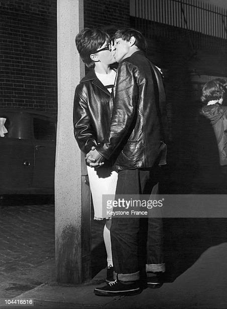 A mod couple in England in the 1960's The boy is wearing jeans the girl high white socks and short hair