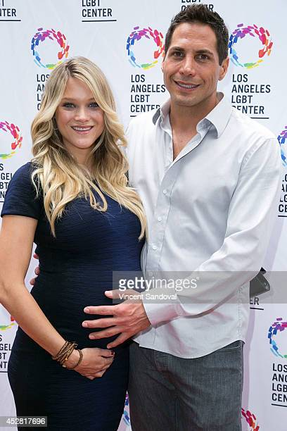 Model Abbey Wilson and Producer Joe Francis attend the GLEH/Los Angeles LGBT Center's Garden Party on July 27 2014 in Los Angeles California