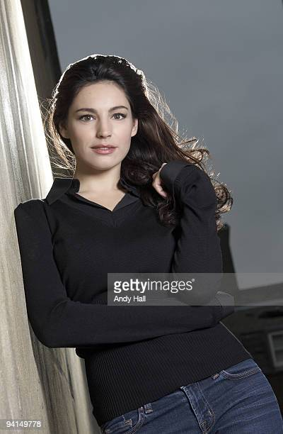 Model actor Kelly Brook poses for a portrait shoot in London on October 7 2009