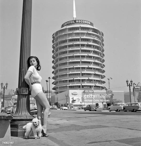 Model actress and future film producer Joan Bradshaw poses by the Capitol Records building on September 8 1957 in Los Angeles California