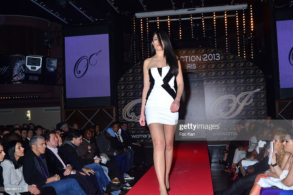 Model / actress Caroline Le Quang dressed by OmarJeans walks the runway during the the 'OmarJeans' Launch Party At The Pavillon Champs Elysees on March 31, 2013 in Paris, France.