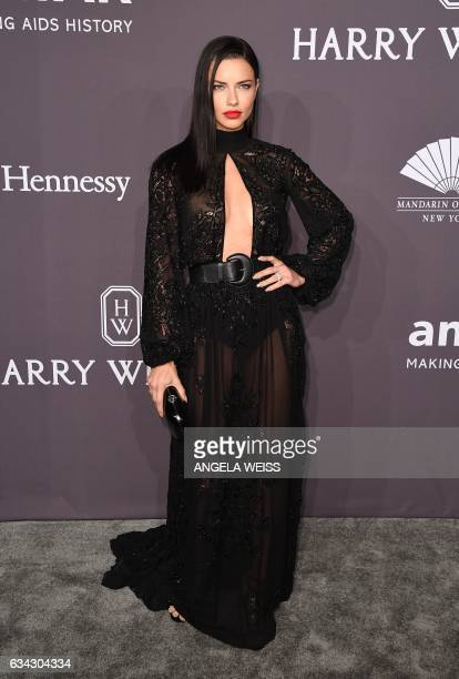 Model Adrian Lima attends the 19th annual amfAR's New York Gala to kick off NY Fashion Week at Cipriani Wall Street on February 8 2017 in New York...