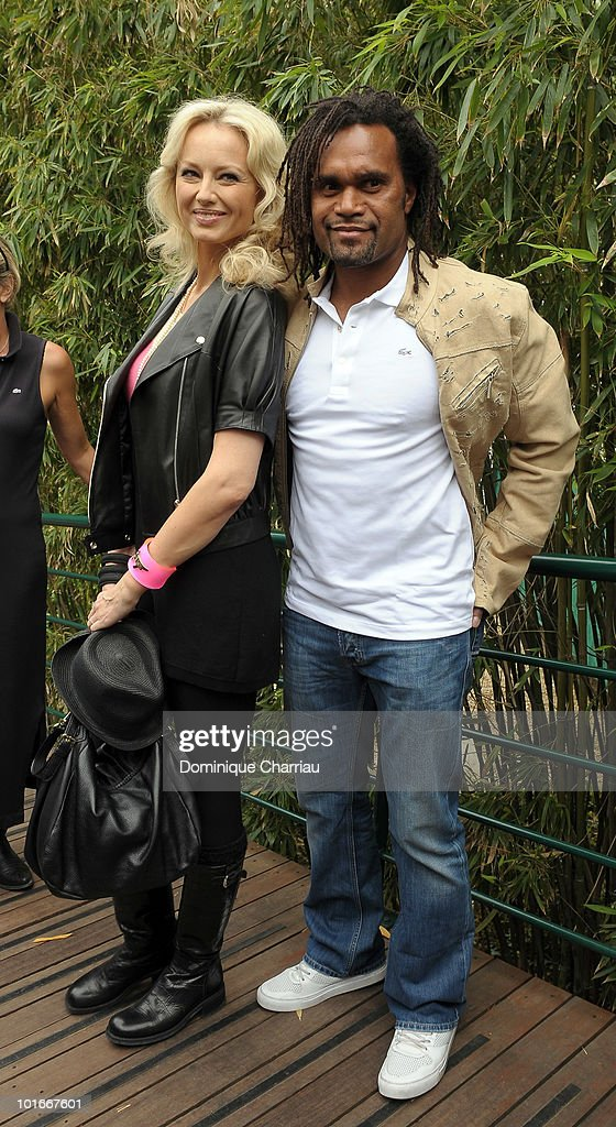 Model <a gi-track='captionPersonalityLinkClicked' href=/galleries/search?phrase=Adriana+Karembeu&family=editorial&specificpeople=207098 ng-click='$event.stopPropagation()'>Adriana Karembeu</a> and <a gi-track='captionPersonalityLinkClicked' href=/galleries/search?phrase=Christian+Karembeu&family=editorial&specificpeople=228704 ng-click='$event.stopPropagation()'>Christian Karembeu</a> are seen at the French Open on June 6, 2010 in Paris, France.