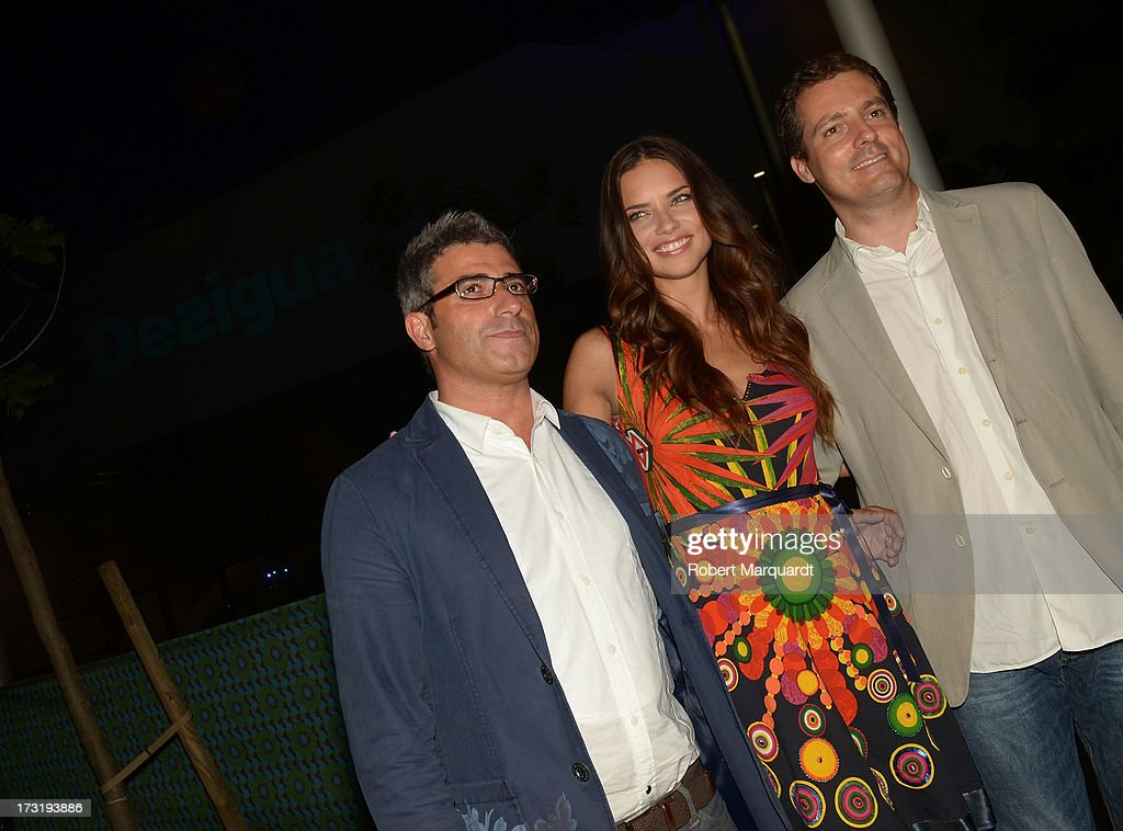 Model <a gi-track='captionPersonalityLinkClicked' href=/galleries/search?phrase=Adriana+Lima&family=editorial&specificpeople=182444 ng-click='$event.stopPropagation()'>Adriana Lima</a> (R) and Director of Desigual Manel Jadraque (L) attend an after party for Desigual's Spring-Summer 2014 Collection 'For Everybody: Sex, Fun & Love' during 080 Barcelona Fashion Week on July 9, 2013 in Barcelona, Spain.