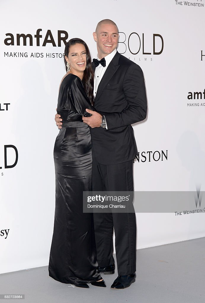 Model Adriana Lima and her boyfriend Joe Thomas attend the amfAR's 23rd Cinema Against AIDS Gala at Hotel du CapEdenRoc on May 19 2016 in Cap...