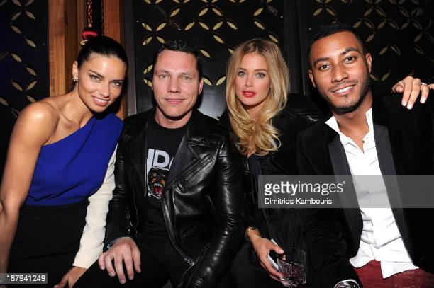Model Adriana Lima DJ Tiesto model Doutzen Kroes and Sunnery James attend the 2013 Victoria's Secret Fashion after party at TAO Downtown on November...