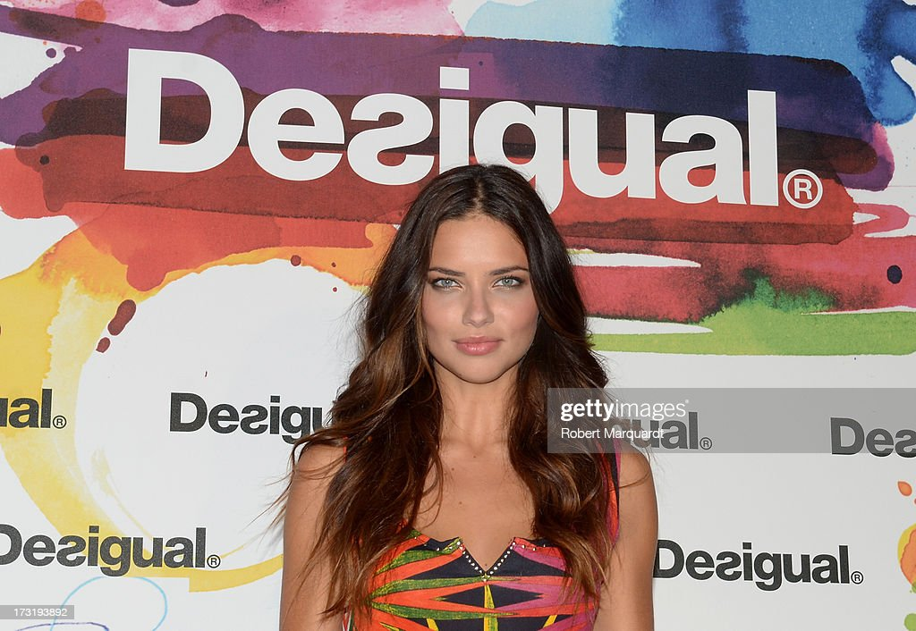 Model <a gi-track='captionPersonalityLinkClicked' href=/galleries/search?phrase=Adriana+Lima&family=editorial&specificpeople=182444 ng-click='$event.stopPropagation()'>Adriana Lima</a> poses during a photocall for Desigual's Spring-Summer 2014 Collection 'For Everybody: Sex, Fun & Love' during 080 Barcelona Fashion Week on July 9, 2013 in Barcelona, Spain.