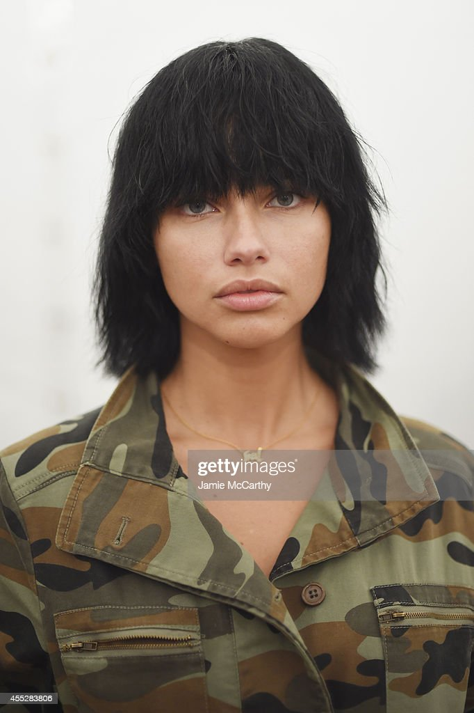 Model Adriana Lima prepares backstage at the Marc Jacobs fashion show during MercedesBenz Fashion Week Spring 2015 at Park Avenue Armory on September...